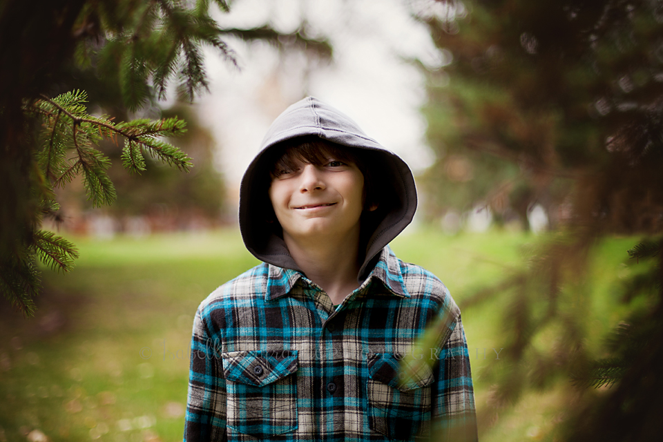 Boy in pine trees